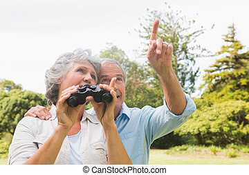 Man showing something to his wife h