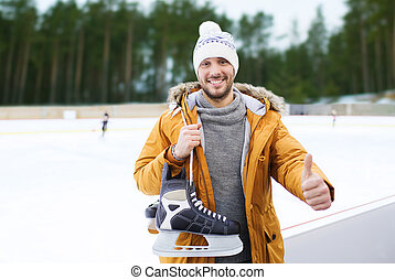 man showing thumbs up on outdoor skating rink - people,...