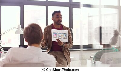 man showing user interface mockup creative team - business,...