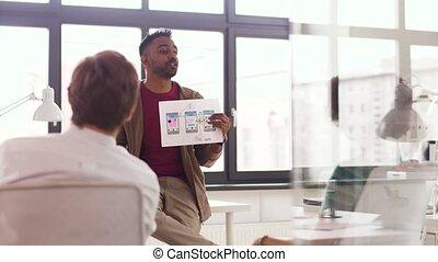 man showing user interface mockup creative team - business,...