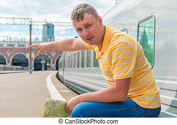 man showing where to go at the station