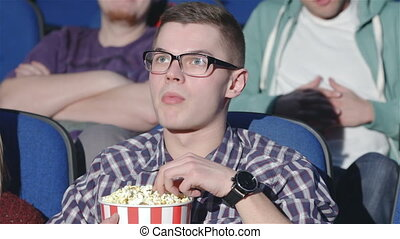 Man shows a gesture of Shh in the cinema