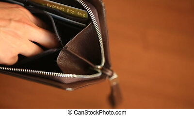 man shows her empty wallet. Bankruptcy. Bankruptcy - Person holding an empty wallet. businesswoman holding looking into empty wallet. The concept of poverty.