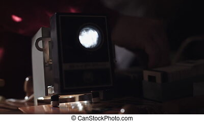 Man shows photos on the slide projector