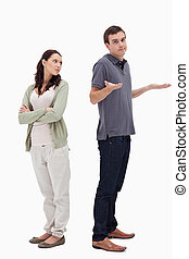 Man shrugged his shoulders back to back with woman