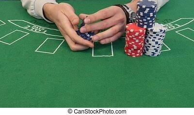Man Shuffling Poker Chips in 4k