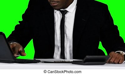 Man sign documents turning. Green screen