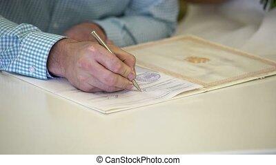 Man sign official document shot