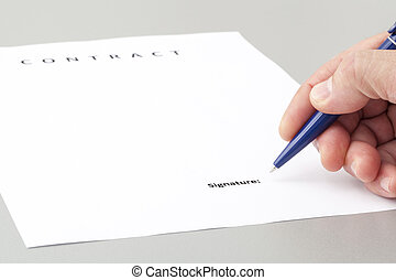 Man Signing a Contract - Stock Image