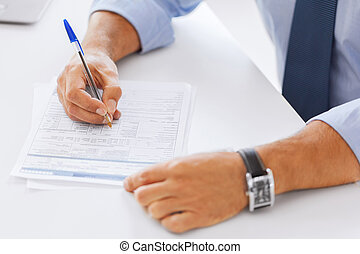 man signing a contract - business, tax, office, school and...