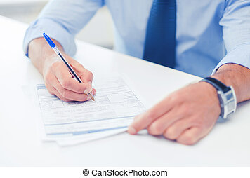 man signing a contract - business, office, school and...