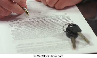 """Man signing document, concluding rent agreement, guy buying car"""