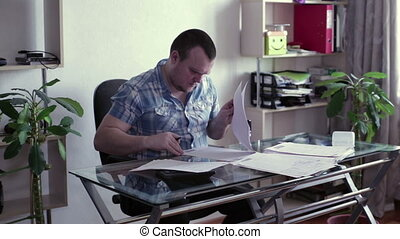 Man signs documents and put a stamp
