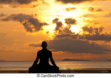 Man silhouette doing yoga exercise