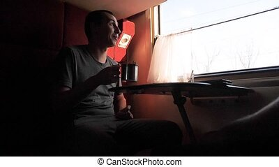 man silhouette is sitting in a Railway carriage train at the...
