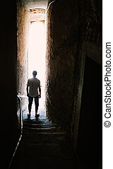 Man silhouette on stairs in narrow street