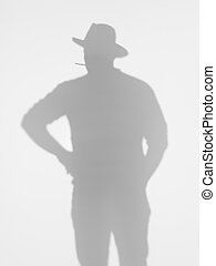 man silhouette smoking a cigarette