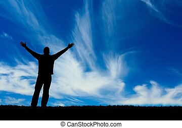 Man silhouette - Silhouette of man with hands raised against...