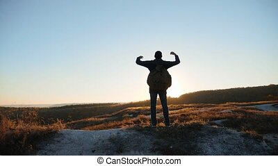 man silhouette striving for success hand to hand walking...