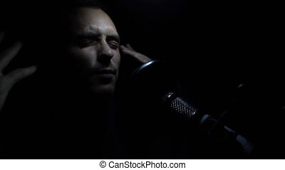 Man singing In Recording Studio with microphone