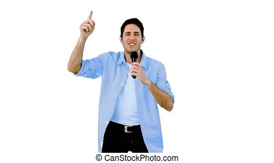 Man singing into microphone on whit