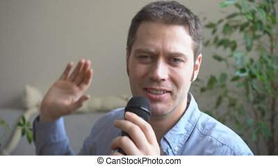 Man singing karaoke at home. Close-up view.