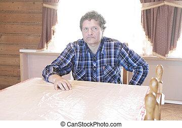 man sits at a table