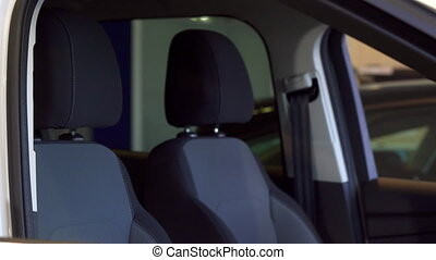 Man sits down into the car - Young african american man...