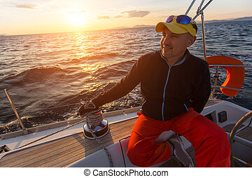 Man sits on a sailboat