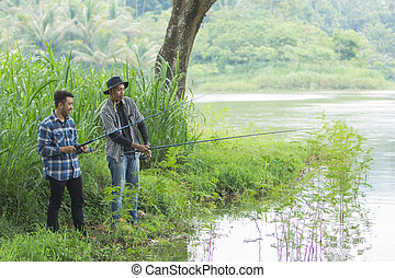 man sits on the riverbank fishing fish