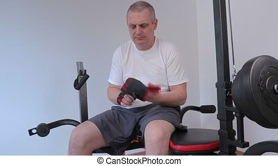 Man sitting and drinking on exercise machine