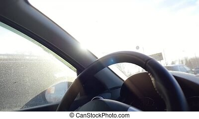 Man sitting and driving in the car under sunset sky in slowmotion. 1920x1080
