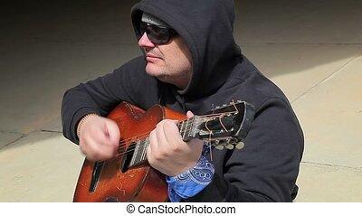 Man sitting and playing guitar