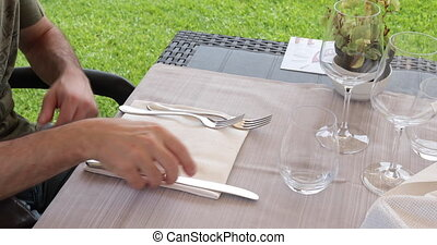Man sitting at a table in outdoor restaurant