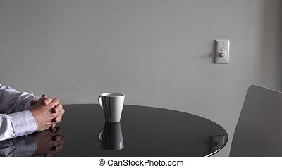 Man sitting at a table upset