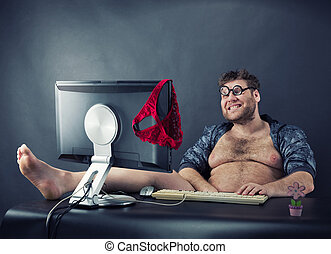 Man sitting at desk looking on computer screen - Fat smiling...