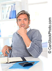 Man sitting at his desk in office