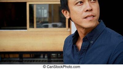 Man sitting at outdoor cafe 4k - Smiling man sitting at...