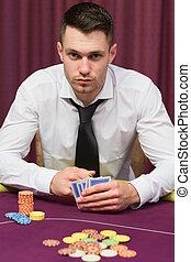 Man sitting at poker table