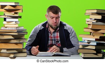 Man sitting at the table begins to fill up. Green screen