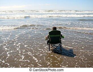 Man sitting in a beach chair.