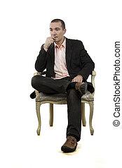 man sitting in a chair