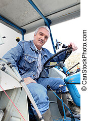 Man sitting in a tractor