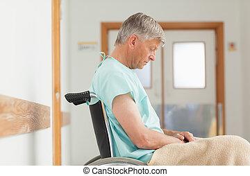 Man sitting in a wheelchair in hospital