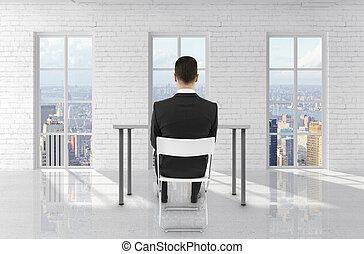man sitting in brick room