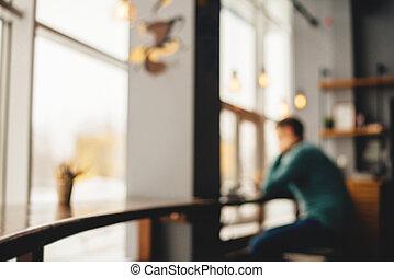 Man sitting in cafe