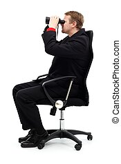 Man sitting in chair and searching with binoculars
