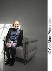 Man sitting in chair.
