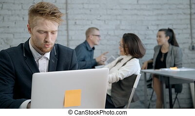 Man sitting in meeting room and using laptop - Concept of...