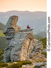 Man Sitting in the Lotus Position on the Rock
